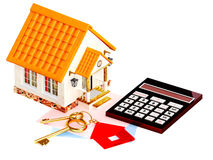Two gold keys, house and calculator Stock Photo