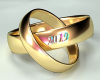 Wedding Rings Ceremony 2019. Two gold marriage rings with a ceremony in 2019. White background Royalty Free Stock Image