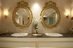 Two gold mirrors stock photography