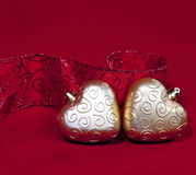 Two gold New Year's hearts and decorative ribbon Royalty Free Stock Images