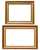 Two gold plated wooden picture frames isolated. On white Stock Images
