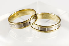 Two gold rings. Isolated on white background Royalty Free Stock Image