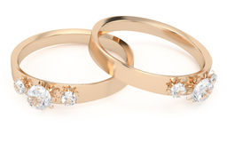 Two gold rings with diamonds Royalty Free Stock Photos