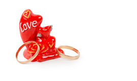Two gold rings with a token of love Stock Photography