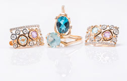 Two gold rings with Topaz stones of different color and set of e Royalty Free Stock Photography