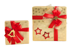 Two gold shiny paper wrap red star bell bow gift box christmas isolated Royalty Free Stock Photo