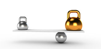 Two gold and silver kettlebells  in equilibrium Royalty Free Stock Photography