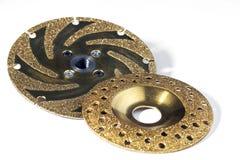 Two gold studded diamond blades Royalty Free Stock Photo