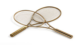 Two gold tennis rackets Royalty Free Stock Photo