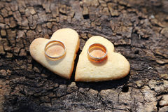 Two Gold Wedding Bands and Hearts Stock Images