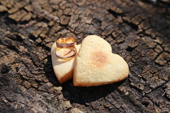 Two Gold Wedding Bands and Hearts Royalty Free Stock Photo