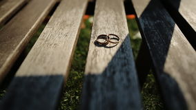 Two Gold Wedding Ring in infinity sign, lying on a. Concept Bride and groom wedding rings. Beautiful stock footage for wedding videos. nice and smooth travel on stock video