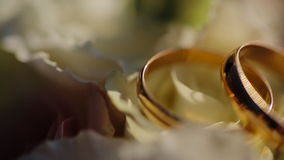 Two Gold Wedding Ring in infinity sign. on lying. Two wedding rings in infinity sign. Love concept stock video