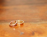Two gold wedding rings Stock Images
