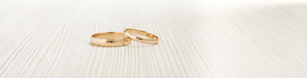 Two gold wedding rings on the bright background Royalty Free Stock Images