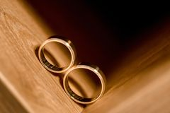 Wedding rings inside wooden cupboard. Two gold wedding rings inside wooden cupboard Royalty Free Stock Photos