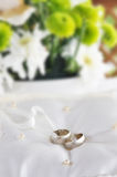Two gold wedding rings on a pillow Royalty Free Stock Photos