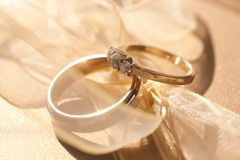 Two gold wedding rings with tender ribbon around Royalty Free Stock Images