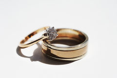 Two gold wedding rings on a white background. Stock Photo