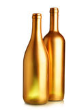 Two gold wine bottles Royalty Free Stock Images