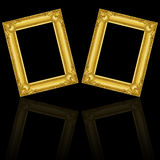 Two gold wooden frames isolated on black with reflection. It is two gold wooden frames isolated on black with reflection Royalty Free Stock Photos