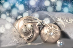 Two golden baubles on abstract background Stock Photo