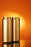 Two golden beer cans Royalty Free Stock Photo