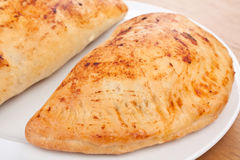 Two Golden Calzone Pizzas Royalty Free Stock Images
