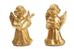 Two golden christmas angel figurines stock photo