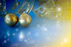 Two golden Christmas ball Stock Photos