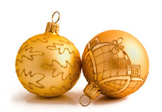Two golden christmas balls isolated on a white Stock Photography