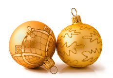 Two golden christmas balls isolated on a white Stock Image