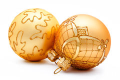 Two golden christmas balls isolated Royalty Free Stock Photography