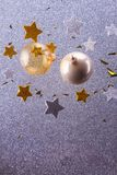 Silver and golden christmas bubbles. Two golden christmas bubble with stars, copy space on silver background stock photo