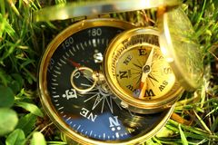 Two golden compasses Stock Photography