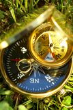 Two golden compasses Stock Images