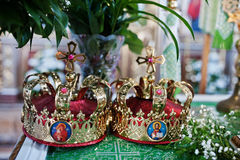 Two golden crowns for wedding ceremony at church. Stock Photo