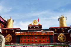 Two golden deer flanking a Dharma wheel on Jokhang Stock Images