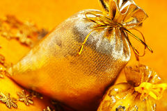 Two golden gift sacks Stock Image