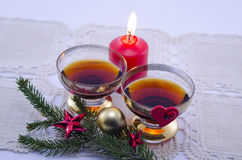 Two golden glasses filled with cognac stock photography