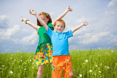 Two golden-haired children playin field Royalty Free Stock Photography