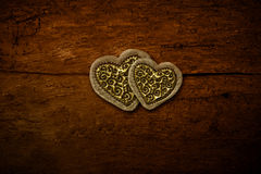 Two golden hearts invitation card Stock Photography