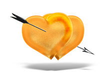 Two golden hearts with an silver arrow love Royalty Free Stock Photo