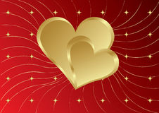 Two golden hearts with stars Royalty Free Stock Photos