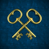 Two golden key isolated on blue background Stock Photography