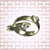 Two golden rings with hearts and diamonds. Isolated with a white stroke stock illustration