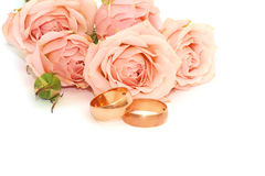 Two golden rings and roses isolated Royalty Free Stock Photo
