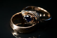 Two golden rings with sapphire and diamonds Stock Photos