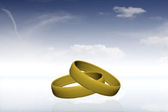 Two golden rings in sky Stock Photo
