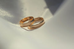 Two golden rings on textile Royalty Free Stock Images
